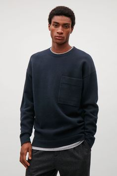 COS image 2 of Relaxed wool jumper with pocket in Navy