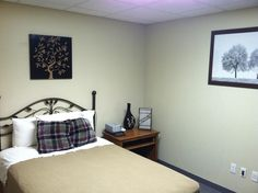 One of our cozy bedrooms in our West Branch locations.