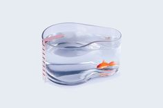Handcrafted glass fish tank shaped as a pool including an elegant copper ladder. Your little fish will feel on holidays.