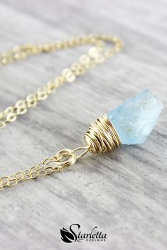 Blue Aquamarine Gemstone Gold Filled Raw Stone Necklace | Wire wrapped in 14kt gold filled wire and hangs from delicate gold filled cable chain. #starlettadesigns #bohochic #bohojewelry #necklace #gemstone #handmade #jewelry Gift ideas | best gift for mother's day | wedding jewelry | gift for her