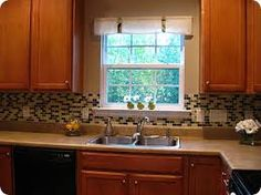 Image result for finishing tile backsplash around window