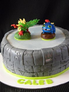 Skylanders Cake - Camo and Wrecking Ball on the Portal of power.  Characters are made of gumpaste.