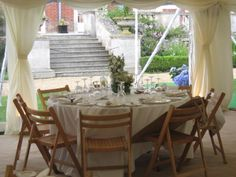 Simple whiter flowers and folding chairs ..