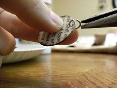 book page necklace... pretty neat... i'd modify it a bit, but great tutorial!