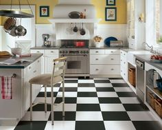 Kitchen design, black and white checkerboard floors, white and yellow overall palate