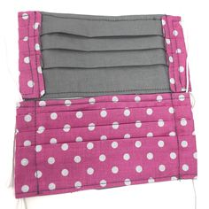 Use promo code PYPMASK4(4for $20) at checkout. One sewn face mask made from cotton fabric and interfacing, ready for use. Priced below materials plus labour cost. Assembledmasks should be laundered either by hand or in a garment bag to preserve the elastic. ***THESE MASKS ARE NOT RATED OR TESTED FOR PERFORMANCE, BUT Lining Fabric, Cotton Fabric, Mask Shop, Pink Polka Dots, Mask Making, Diaper Bag, Labour Cost, Face, Preserve