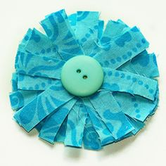 Scrappy Fabric Flower - Put your pile of fabric scraps to a fun and floral use. Sew this Scrappy Fabric Flower using any fabric scraps you have leftover from other sewing projects. These flowers can be sewn onto anything to add a quick embellishment. There are plenty of ways to creatively decorate with this simple project.