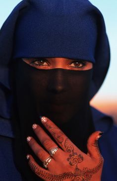 Beautiful covered Muslim Woman. Eye liner, henna, nail designs and rings.