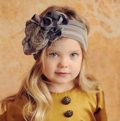 Rosette headband. I wish I was bold enough to actually wear it myself. My kids will though!