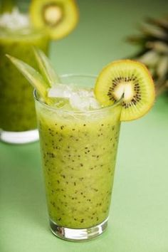 Kiwi Smoothie - 4 ripe kiwis, peeled and cut into chunks  1 1/3 cups apple juice  1 cup frozen yogurt  Honey or sugar to taste