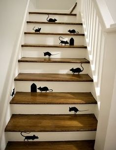 Thinking about doing a staircase remodel for your home? Here is a clever staircase idea. Check out this black mice and mouse holes painting on wooden stairs.