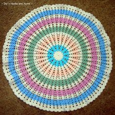 Make your very own round crochet afghan with the Ferris Wheel Baby Blanket pattern. Rounds of pastel colors make this crochet baby blanket pattern light and eye-catching.
