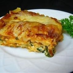 An easy vegetarian lasagna is filled with spinach and ricotta cheese and has a topping of mozzarella and Parmesan.