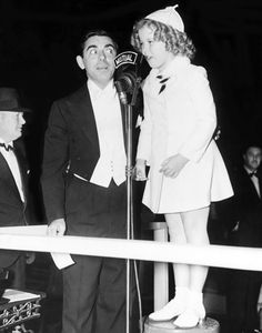 Eddie Cantor and Shirley Temple at the premiere of Wee Willie Winkie, 1937.