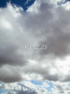 grey clouds on blue sky - Image of grey clouds on blue sky