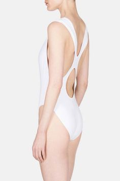 Designer Araks Yeramyan built her label on flawlessly flattering lingerie and has since branched out into ready-to-wear, sleepwear, and swimwear, all crafted with a minimalist ease. This modern and elegant one-piece swimsuit both conceals and reveals, with wide straps that frame a flattering scoop neckline and create a play of lines, curves, and cutouts as they intersect at the back.