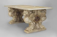 """Pair of Italian Neo-classic (18th Cent) white marble bases with 2 carved winged lions having claw feet centering a rouge and Siena marble rondel supporting a later marble top Price $145,000.00 78"""" w x 37.5"""" d x 31.5"""" h"""