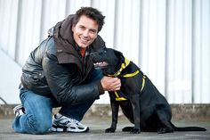 """John Barrowman Photos - Entertainer John Barrowman is seen out promoting the Dog Trust, spreading the message """"A dog is for life, not just for Christmas"""". Barrowman happily posed with pups Mouse the Black Labrador and Vincent the Jack Russell Terrier. - John Barrowman Promotes Dog Trust Dogs Trust, John Barrowman, Black Labrador, Jack Russell Terrier, Pup, Poses, Christmas, Life, Fictional Characters"""