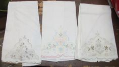 Three hand-embroidered and appliqued tea towels, linen, from Madeira Portugal.
