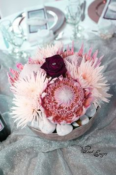 Centerpiece with proteas, roses and anastasia - Stone Haven on Vaal - Floral Design & Decor  by www.pinkenergyfloraldesign.co.za Centerpieces, Table Decorations, Anastasia, Floral Design, Roses, Stone, Pink, Home Decor, Rock