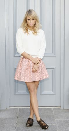 Suki Waterhouse pink skirt white sweater street style.