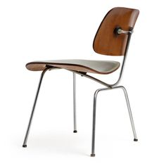 Leather DCM Chair by Charles and Ray Eames | From a unique collection of antique and modern dining room chairs at https://www.1stdibs.com/furniture/seating/dining-room-chairs/