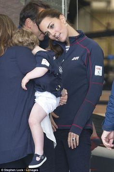 Concerned: Kate chats to an onlooker and her crying tot after the race has been cancelled...
