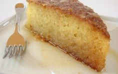 Easy and delicious coconut cake which will delight your family. It's very fast t… Easy and delicious coconut cake which will delight your family. It's very fast to prepare and it's even softer and juicer when poured with t… food desserts Greek Sweets, Greek Desserts, Greek Recipes, Just Desserts, Syrup Cake, Macedonian Food, Cake Recipes, Dessert Recipes, Coconut Syrup