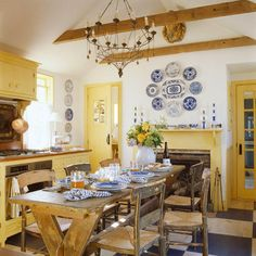 Gary-McBournie-yellow-kitchen-Nantucket-Traditional-Home (?ASCP in cream on cabinets; accent with blue/white)