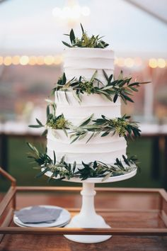 Olive branch covered cake: http://www.stylemepretty.com/utah-weddings/2015/04/22/multi-cultural-winter-wedding-at-entrada/   Photography: Gideon - http://www.gideonphoto.com/