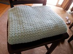 A soft, squishy baby blanket any Mother-to-be will love. This blanket is easily customizable and the pattern is quickly memorized. Great for a beginner, this blanket is simplicity itself with no border and only single and double crochet stitches. Pattern includes small and large blankets, using either one or two skeins of Lion Brand Pound of Love.