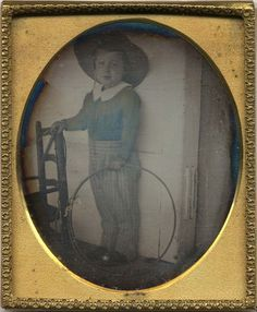 An Henry Insley Daguerreotype...ca.1850. This is the photographer's son, and I rather think it is experimental. Perhaps, he was trying to cut down on exposure time. The clothing, the toy hoop, the chid's chair: all very interesting.