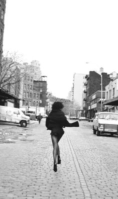 woman walking down the street like she is running out of something...