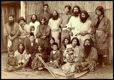 """TWENTY NATIVE AINU IN HOKKAIDO, JAPAN by Okinawa Soba, via Flickr. Ca. 1890-1900 albumen print of a fine group of Ainu who look """"none too happy"""" about having their photo taken --- except for that little kid sitting right in the middle who looks like he's trying to smother a good laugh."""