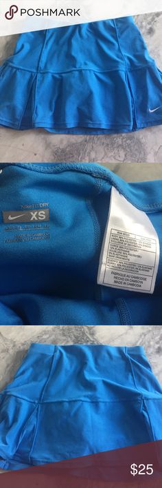 Nike dri fit skort Nike- Periwinkle blue fit dry skort. Used once. Like new!  Perfect for Golf ⛳️ or Tennis 🎾. Nike Shorts Skorts