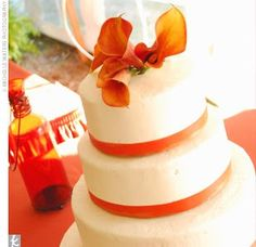 Orange calla lilly wedding cake Google Image Result for http://www.wyomingweddingsonline.com/blog/wp-content/uploads/2011/10/weddingproposalsitecom.jpg