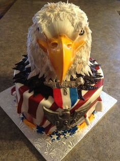 Eagle sculpted cake, with RC beak.  Hand made medal and ribbon from mmf.  Feathers are a fun way to release your energy!