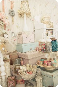 vintage/shabby chic. Lots of neat ideas in this display. I lke the doily in the footed bowl for storing items...