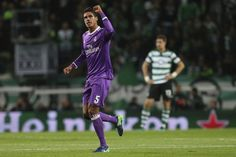 Real Madrid's Raphael Varane celebrates after scoring the opening goal of his team during the Champions League Group F soccer match between Sporting CP and R...