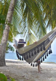 gratify guests with the sophisticated relaxation of the aguadas hammock  designed with supreme elegance in mind the black tassels on this handwoven piece     cotton hammock handmade hammock indoor hammock white hammock      rh   pinterest