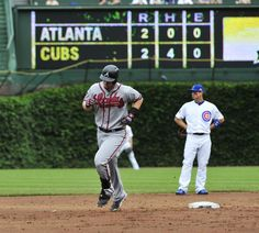 Chris Johnson #23 runs the bases on two-run homer against the Chicago Cubs during the second inning on July 12th 2014 at Wrigley Field!