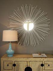 DIY sunburst mirror with branches