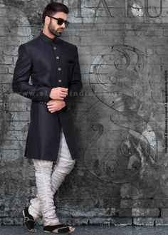This Dark grey indowestern suit is a perfect wear for a personality with classic taste. It is crafted with beautiful buttons and in front and wrist. It is complimented with rich combination of white linen and maroon pocket square Indian Groom Wear, Indian Wedding Wear, Wedding Men, Wedding Suits, Wedding Dress, Indian Men Fashion, India Fashion, Mens Fashion, Mens Sherwani
