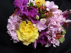 An arrangement featuring purple mokara orchids, pink hydrangea and yellow roses.  To purchase any of our floral selections, as gifts or décor, please call us at 800.520.8999 or visit our e-commerce portal at www.Starbrightnyc.com. This composition of flowers is generally available for same day delivery in New York City (NYC).