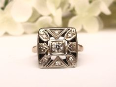What a lovely and unique square style engagement ring this is! The antique ring has a beautiful eye-clean 0.10 carat Old European Cut
