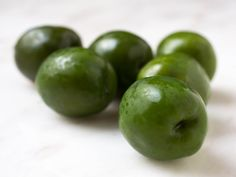 Castelvetrano olives are Italy's most ubiquitous snack olive. Bright green, they're often referred to as dolce (sweet), and come from Castelvetrano, Sicily, from the olive variety nocerella del belice. They have a Kermit-green hue, meaty, buttery flesh, and a mild flavor. Consider serving them with sheep's milk cheese and a crisp white wine.