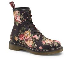 Apparently the industrial, lug soled boot is back with a twist this fall...these above the ankle, Victorian floral print Doc Martens are both feminine and tough.