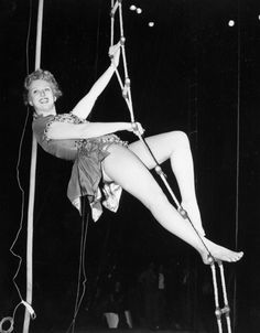 Actress Celeste Holm ascends a rope ladder during rehearsal for a circus opening night at Madison Square Garden in New York, on April Stage and screen stars took part in the benefit show,. Celeste Holm, Jane Wyman, Madison Square Garden, Famous Women, Concert, Lady, Image, July 15, Actresses
