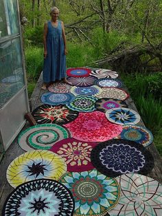 (Note: I didn't take this photo, our friend Barb did)  Sage's mom, who still lives near where we lived in the Ozarks, takes apart peoples' discarded sweaters and reassembles them in to these gorgeous rugs.  I've seen her work for years but not all together like this.  Very striking.    This batch is headed off to be sold at the Midwest Wimmins' Festival.  Thanks to Barb for coming up with the idea for this photo and then making it happen..