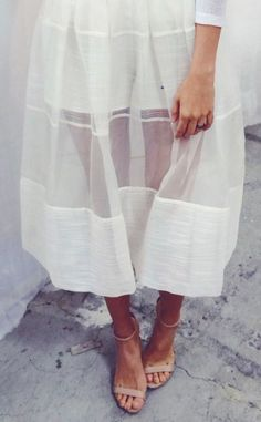 FOR STYLE INSPIRATION || Sheer white midi skirt with nudge handle strap high heeled sandals || NOVELA...where the modern romantics play & plan the most stylish weddings...Instagram: @novelabride www.novelabride.com